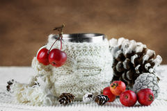 Cup in knitted cover with paradise apples Royalty Free Stock Photos