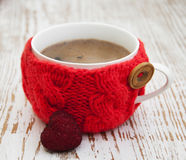 Cup with knitted thing Stock Image