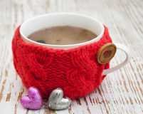 Cup with knitted thing Royalty Free Stock Photos