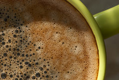 Cup with kofem closeup. Green cup of coffee close-up Stock Photography