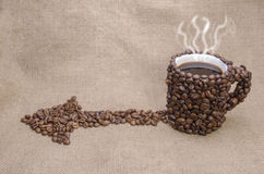 Cup in the kofenykh grains. More hotly than coffee against coffee grains and a beautiful background Stock Photo