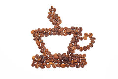 Cup is laid out from the corns of coffee. Isolated on a white background Royalty Free Stock Images