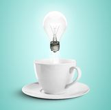 Cup and lamp Stock Images