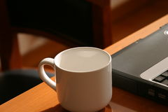 Cup and laptop. Office at home Royalty Free Stock Photos
