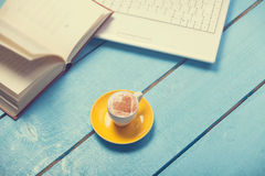Cup with laptop and book Stock Photography