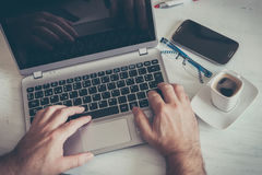 Cup and laptop Royalty Free Stock Photography