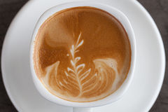 A cup of latte art Stock Photos