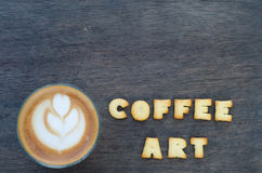 A cup of latte art and alphabet Royalty Free Stock Photo