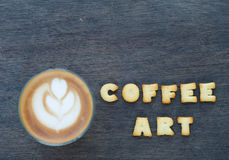 A cup of latte art and alphabet Royalty Free Stock Photography