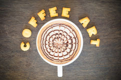 A cup of latte art and alphabet Royalty Free Stock Image