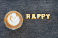 A cup of latte art and alphabet Stock Image
