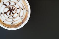 A cup of latte art Stock Photos