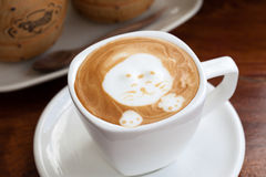A cup of latte art coffee Royalty Free Stock Images