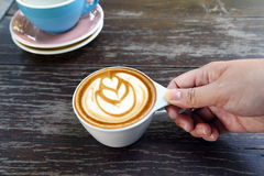 A cup of latte art coffee Stock Photos