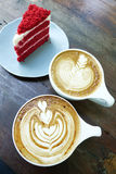 Cup of latte art coffee and cake. On wood table stock photo