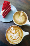 Cup of latte art coffee and cake. On wood table royalty free stock photo