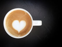Cup of latte art coffee heart symbol Stock Image