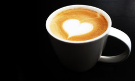 Cup of latte art coffee heart symbol Royalty Free Stock Photography