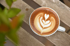A cup of latte art coffee Royalty Free Stock Photo