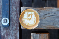 Cup of latte art coffee Stock Photos