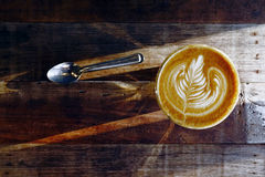 Cup of latte art coffee Stock Photography