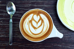 Cup of latte art coffee Stock Images