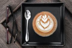 Cup of latte art coffee on wooden background Stock Photography