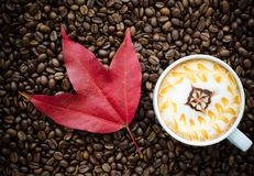 A cup of latte art and maple leaf Stock Image