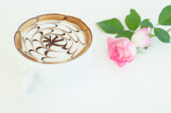 A cup of latte art and rose Stock Image