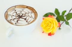 A cup of latte art and rose Stock Photography