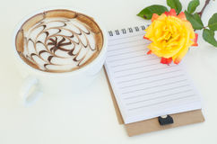 A cup of latte art and rose Royalty Free Stock Image