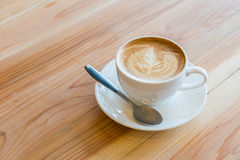 Cup of latte art on wood table Royalty Free Stock Images