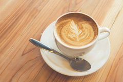 Cup of latte art on wood table stock photo