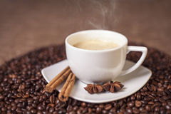 Cup of latte or cappuccino with cinnamon and anise Stock Photos