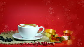 Cup of latte, cappuccino or espresso coffee with milk put on the red background with dark roasted coffee beans Stock Photos