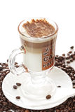 Cup of latte coffee on beans Stock Photo