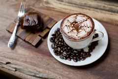 Cup of latte coffee with brownie cake Royalty Free Stock Image