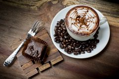 Cup of latte coffee with brownie cake Stock Images
