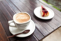 Cup of latte coffee. With cake Royalty Free Stock Image