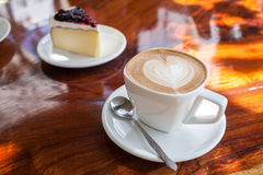 Cup of latte coffee. With cake Royalty Free Stock Photo