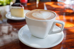 Cup of latte coffee. With cake Stock Photos