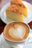 Cup of latte coffee with cake Royalty Free Stock Photography