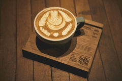 Cup of latte coffee on coaster wood vintage style Stock Image