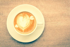 Cup of latte coffee with heart drawing , vintage style stock image