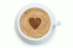 Cup of latte coffee with heart on the froth. White cup of latte with heart on its froth Stock Photos