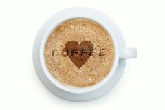 Cup of latte coffee with heart on the froth Stock Images