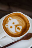 Cup of latte coffee like face bear Stock Photography