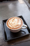 Cup of latte coffee. On table Royalty Free Stock Photo