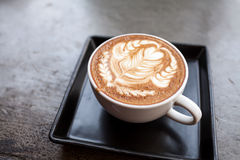 Cup of latte coffee. On table Royalty Free Stock Image