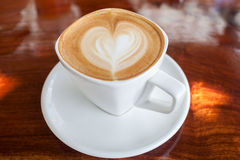 Cup of latte coffee. On table Stock Photography